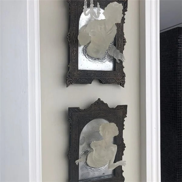 VICTORIAN GHOSTS EMERGING FROM A MIRROR